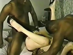 Two ebony guys share a white wife and pound her pussy relentlessly