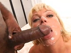 Her tongue is extended to receive shots of hot cum from her black lover